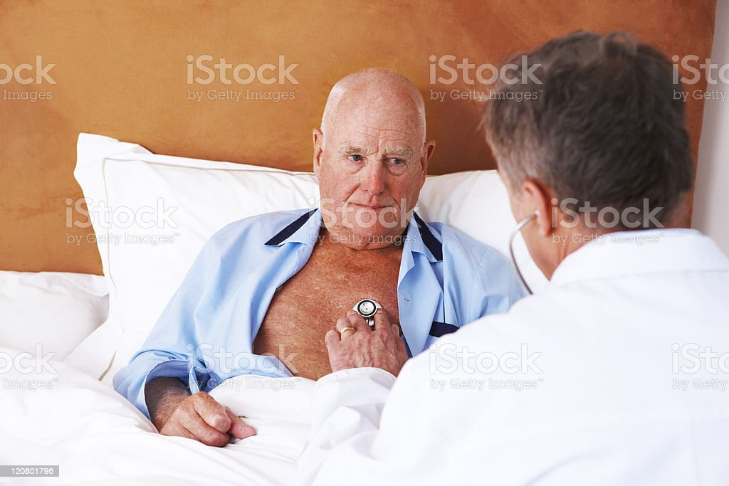 Doctor Checking the Heart of a Senior Man royalty-free stock photo