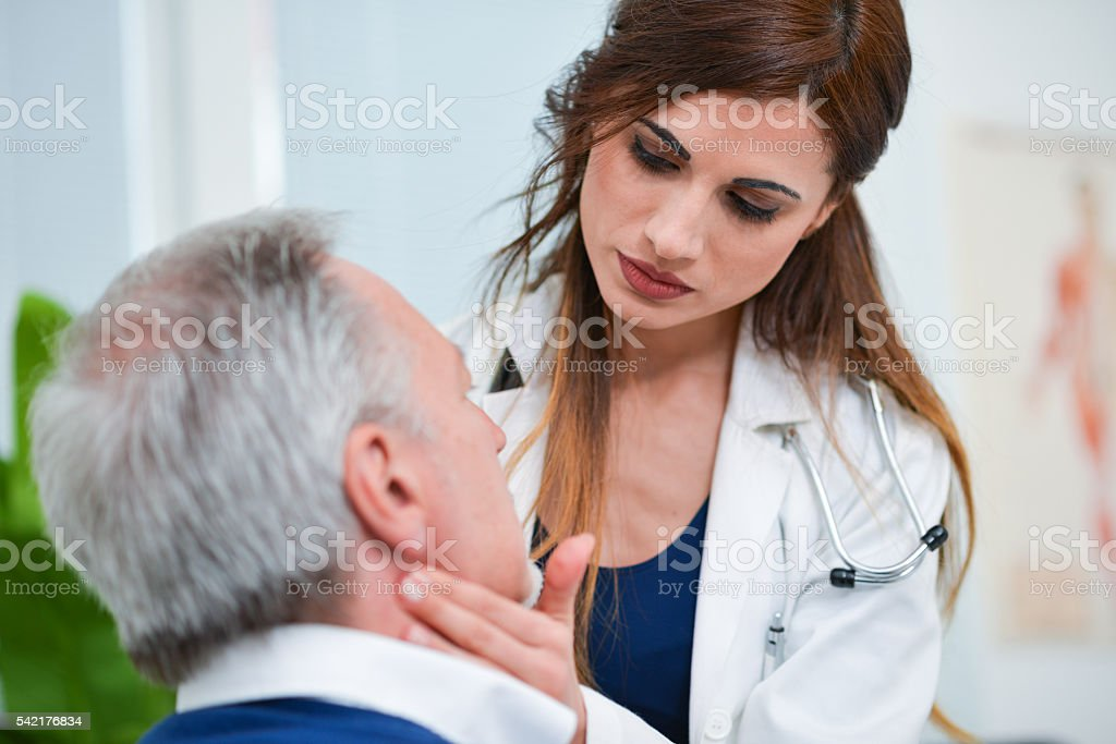 Doctor checking the lymph nodes size stock photo
