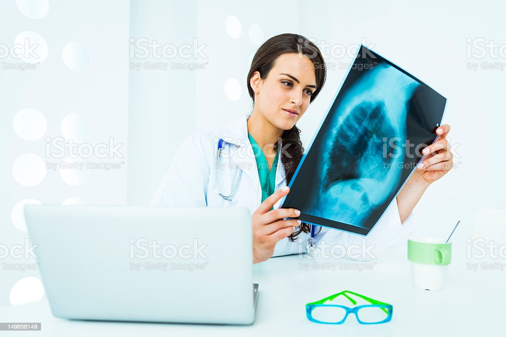 Doctor checking x ray of lungs stock photo