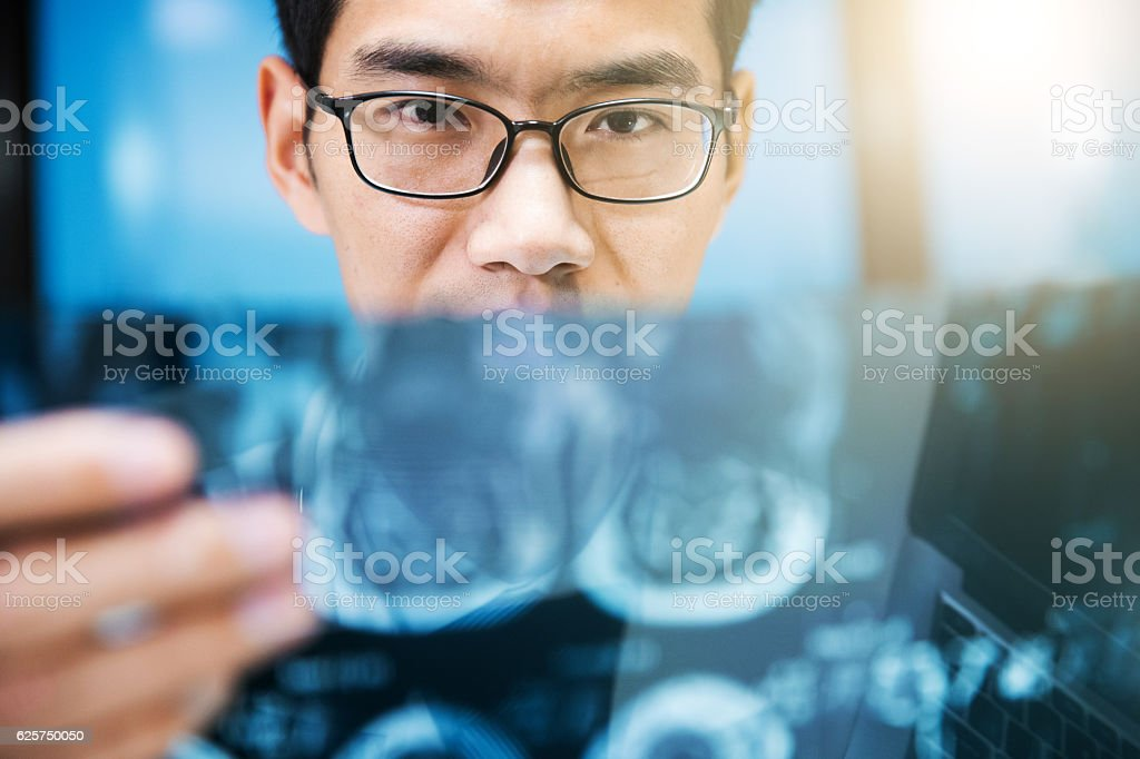 Doctor checking x-ray photo stock photo
