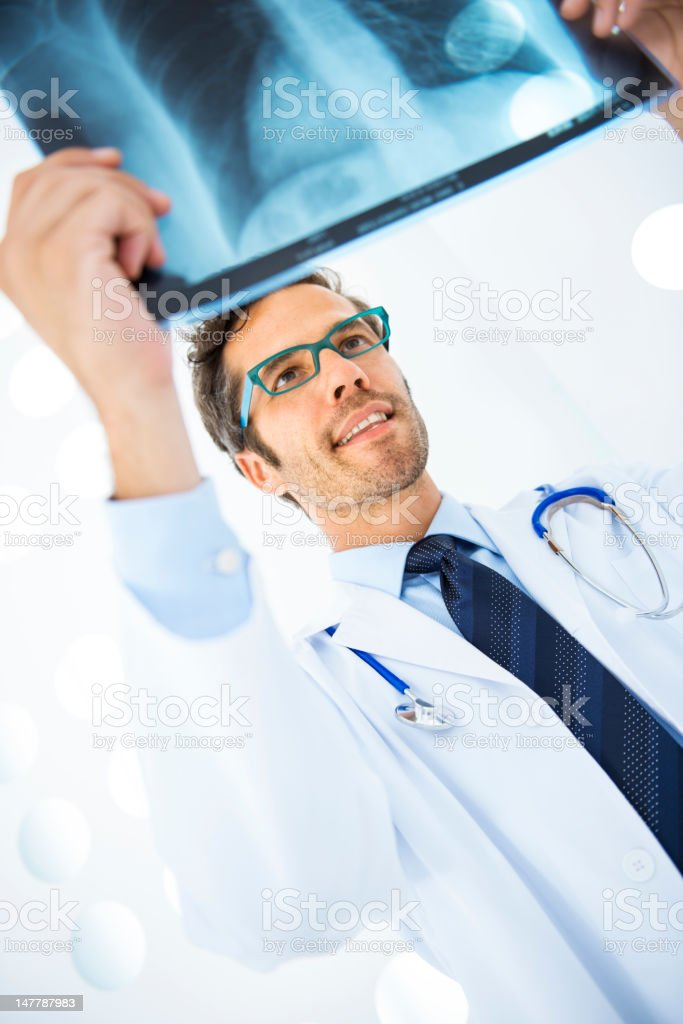 Doctor checking X-Ray royalty-free stock photo