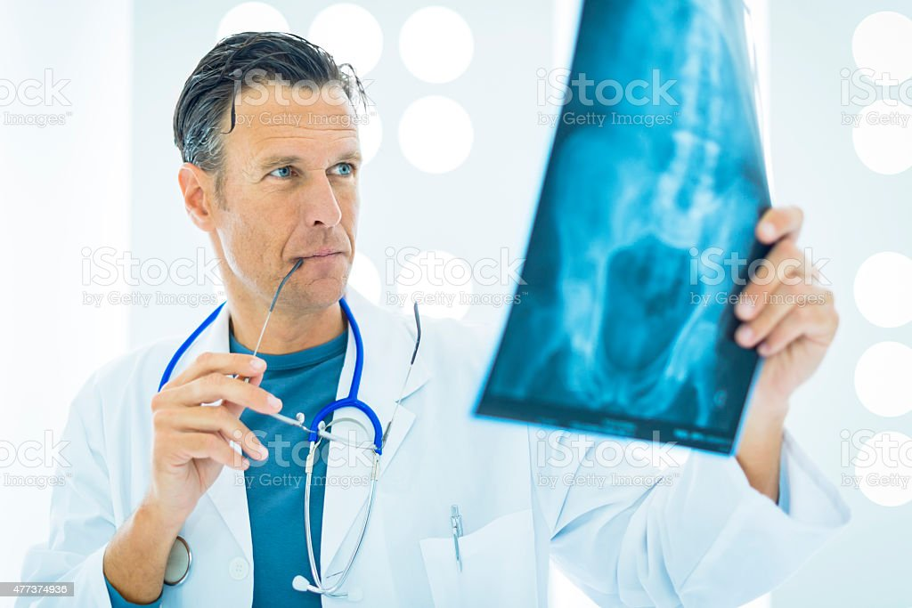 Doctor checking X-Ray stock photo