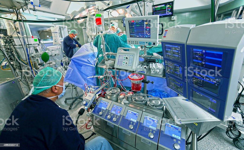 Doctor checks data of cardiopulmonary bypass machine stock photo