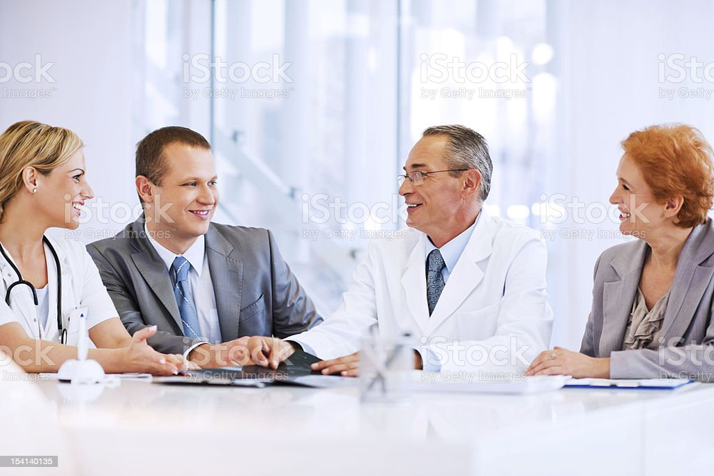 Doctor Collaborating with a Business Team royalty-free stock photo