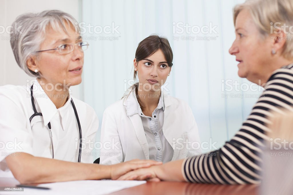 Doctor comforting pacient stock photo