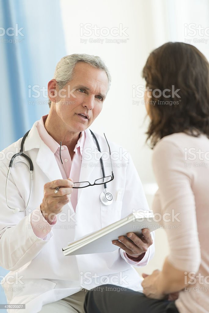 Doctor Communicating With Female Patient stock photo