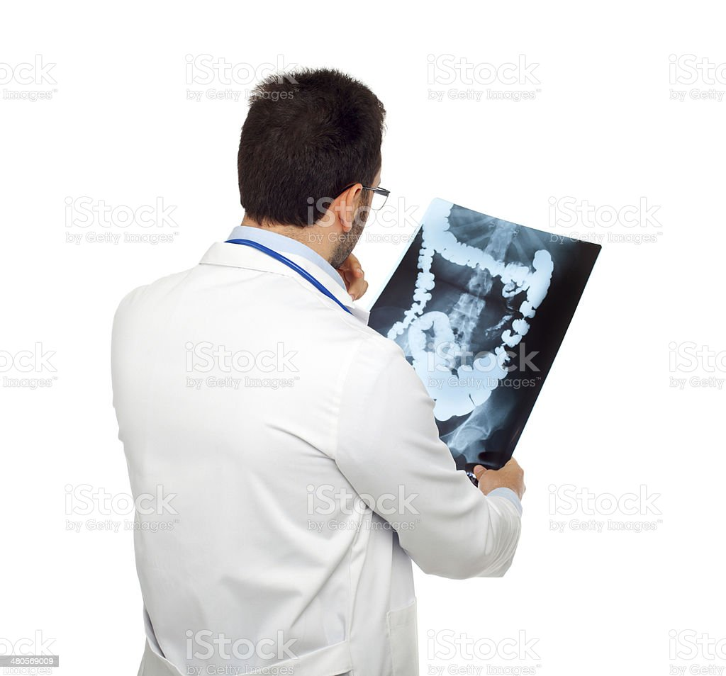 Doctor consulting a bowel radiography stock photo