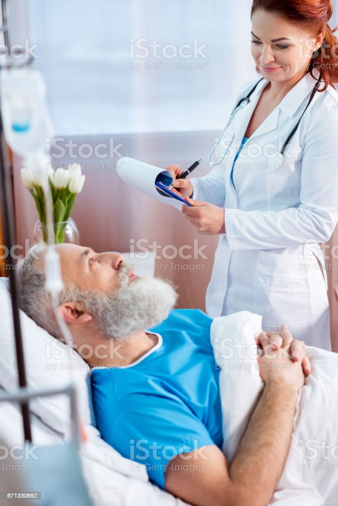 Doctor consulting patient stock photo