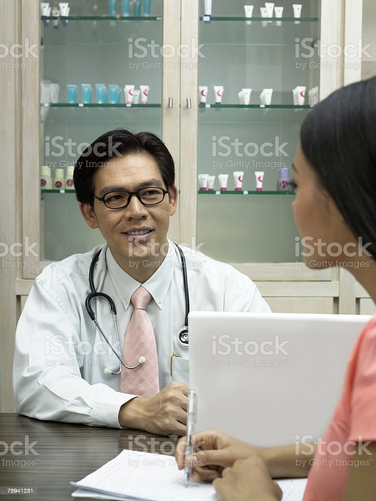 Doctor consulting patient royalty-free stock photo