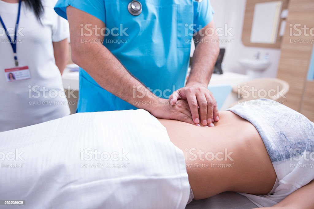 Doctor Controlling Patient stock photo
