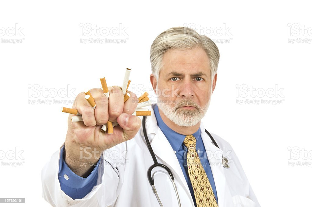 Doctor Crushing Cigarettes royalty-free stock photo