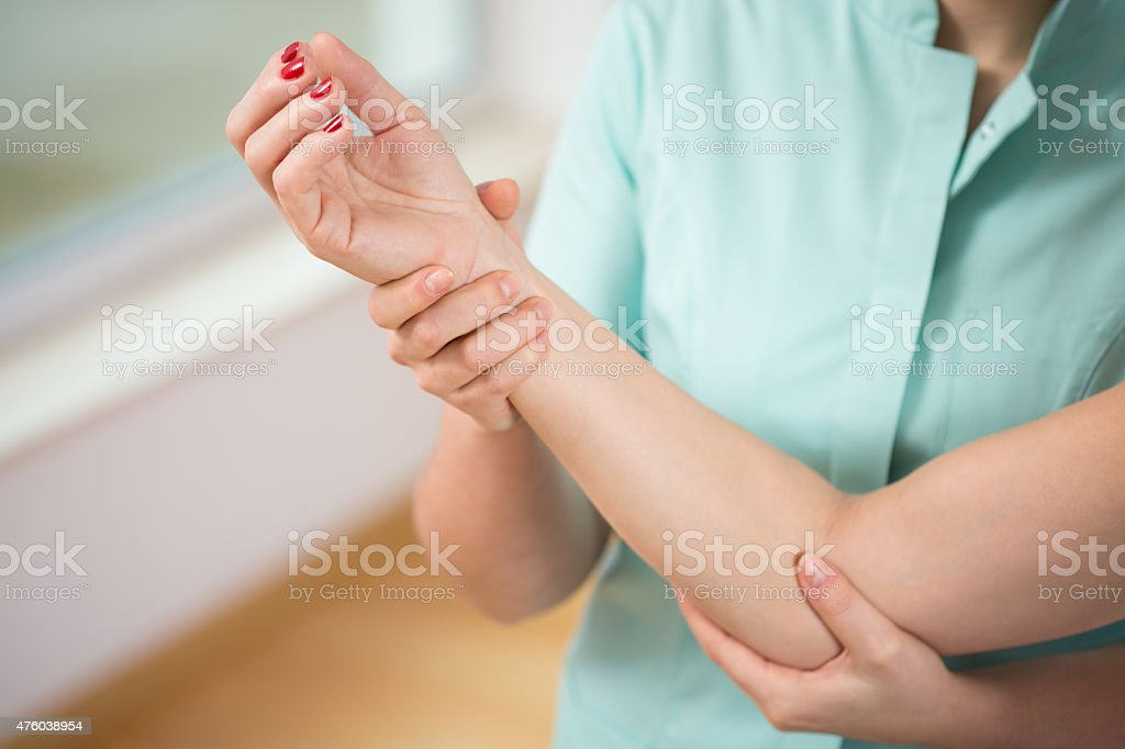 Doctor diagnosing painful elbow stock photo