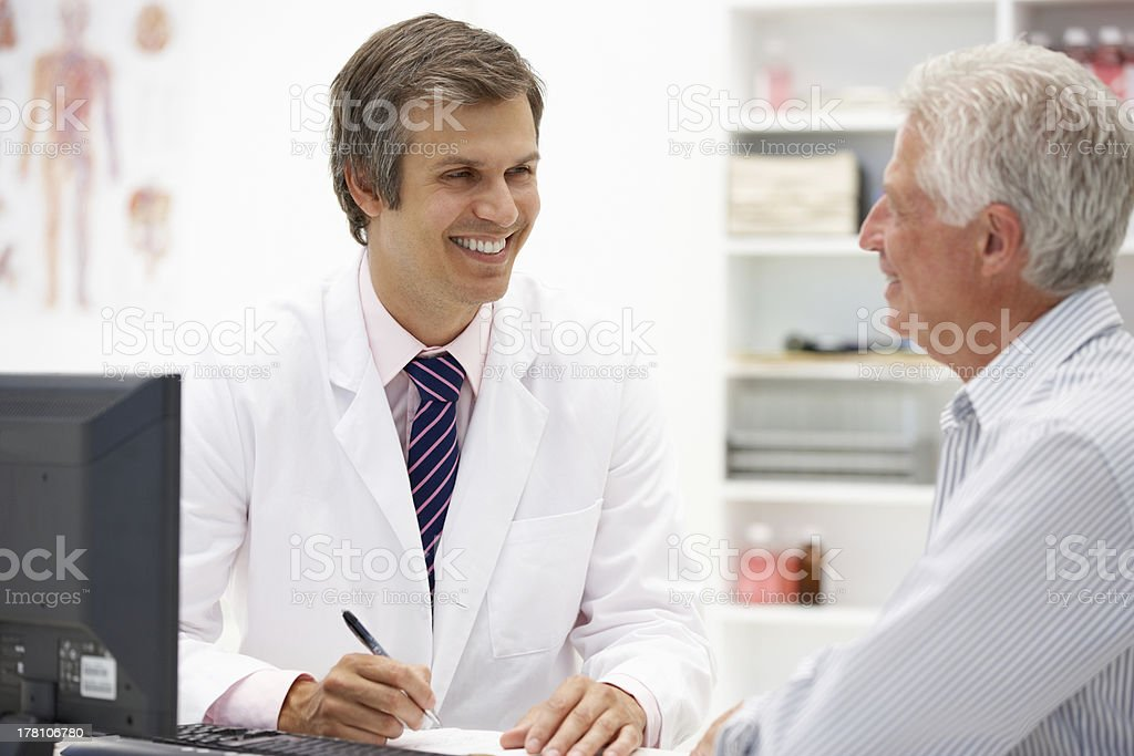 Doctor discussing medical condition with senior patient royalty-free stock photo