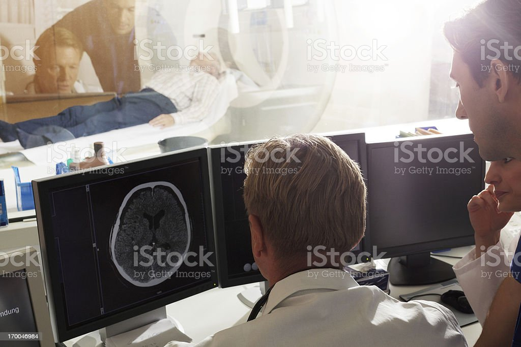 Doctor discussing MRI Scan stock photo