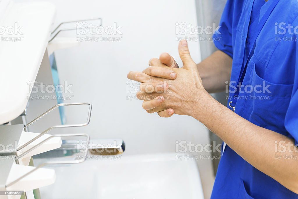 Doctor Disinfecting His Hands royalty-free stock photo