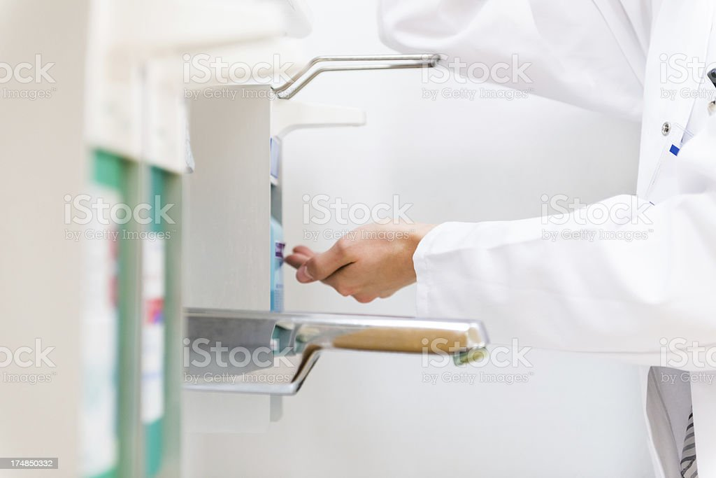 Doctor Disinfecting His Hands stock photo