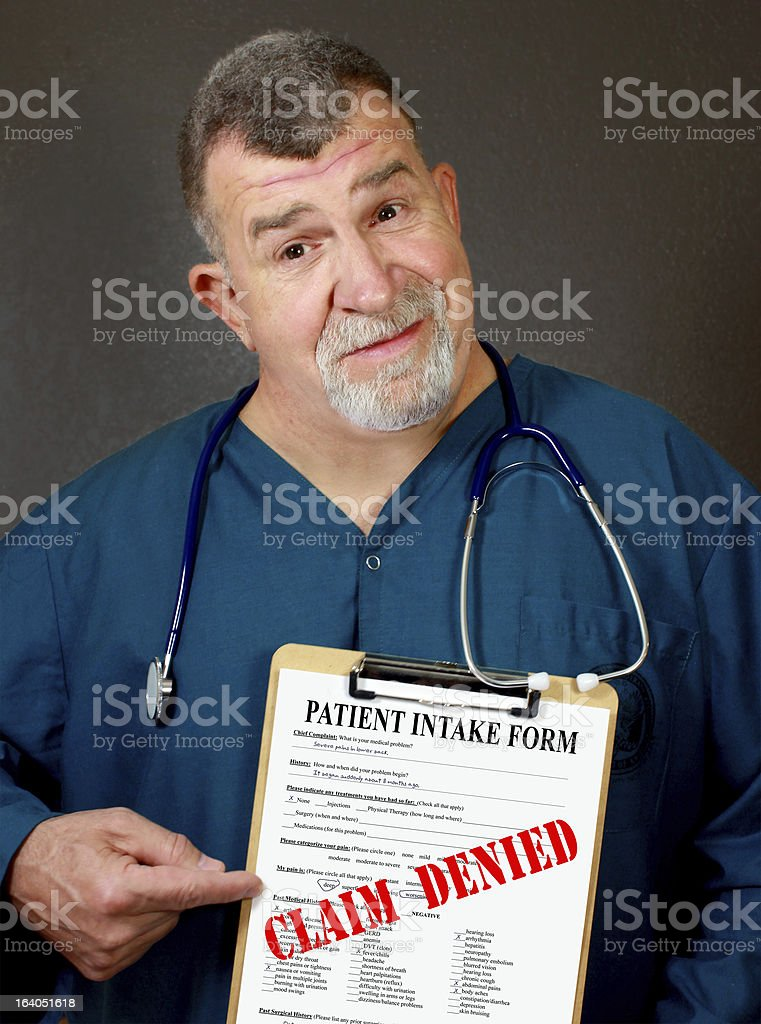 Doctor Displays 'CLAIM DENIED' Medical Form stock photo
