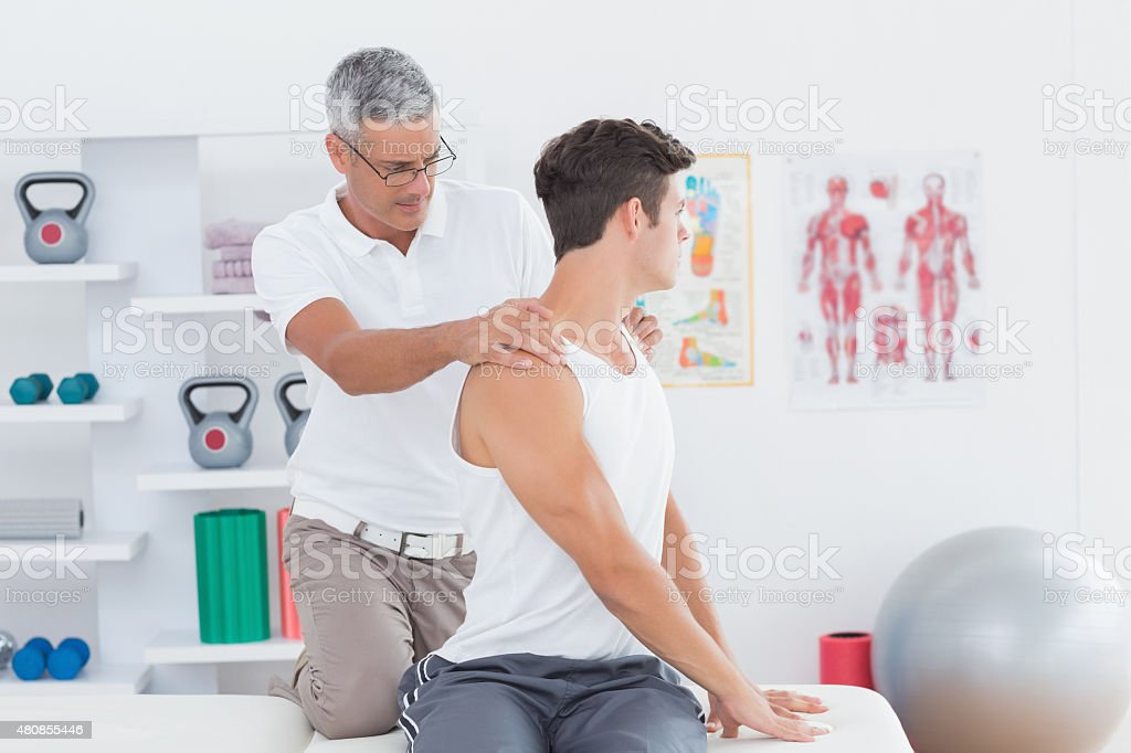 Doctor doing back adjustment stock photo