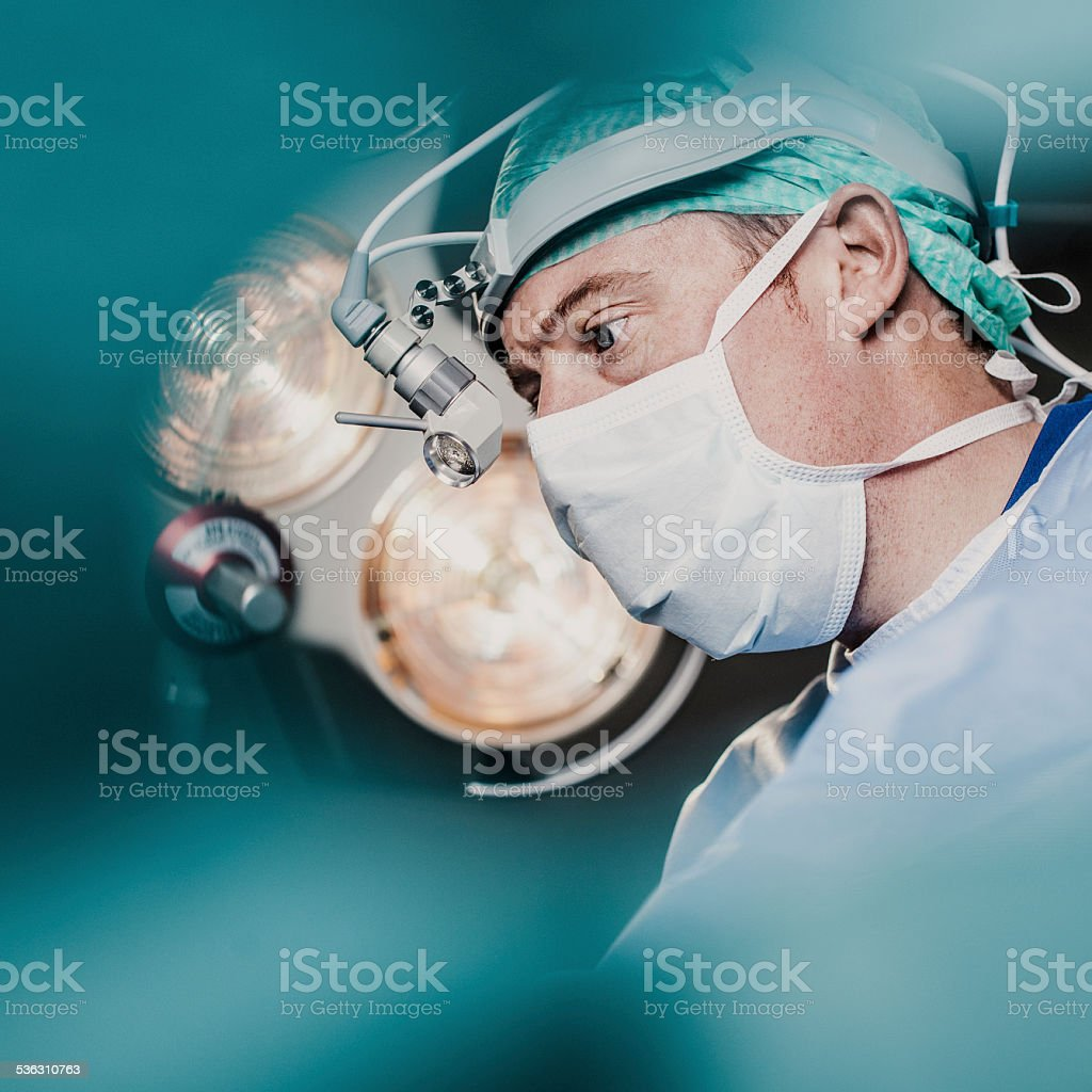 Doctor doing surgery in hospital stock photo