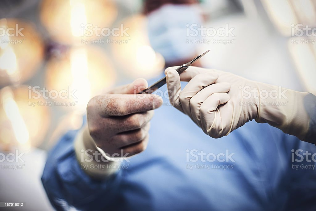 Doctor doing surgery stock photo