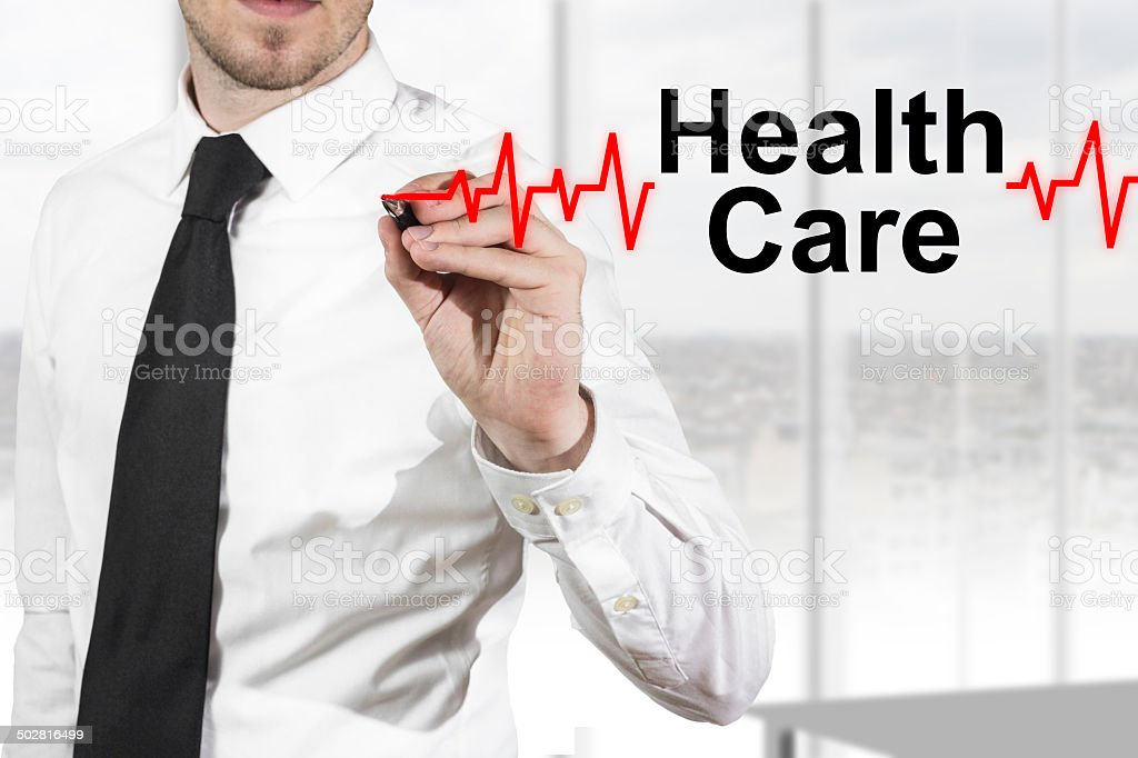 doctor drawing heartbeat health care stock photo