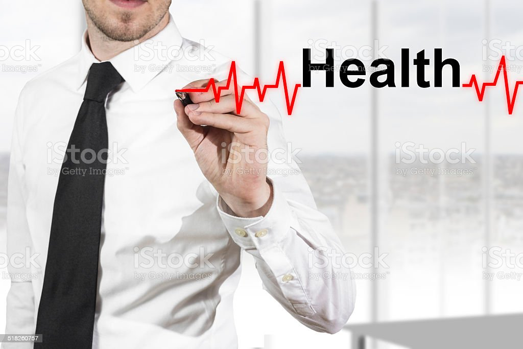 doctor drawing heartbeat health stock photo