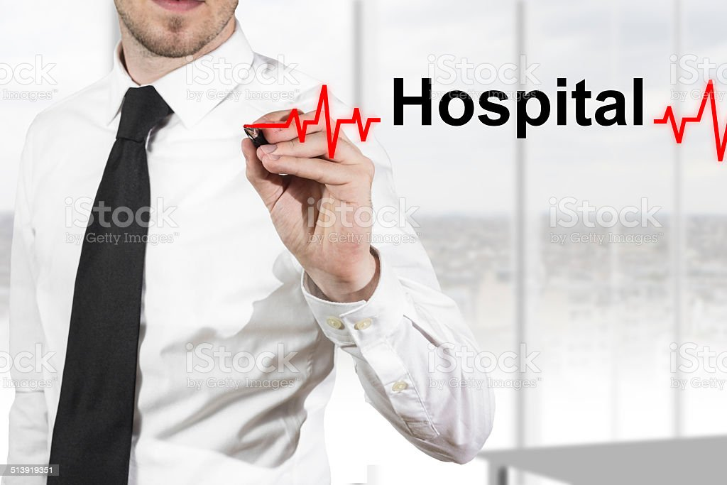 doctor drawing heartbeat line hospital stock photo