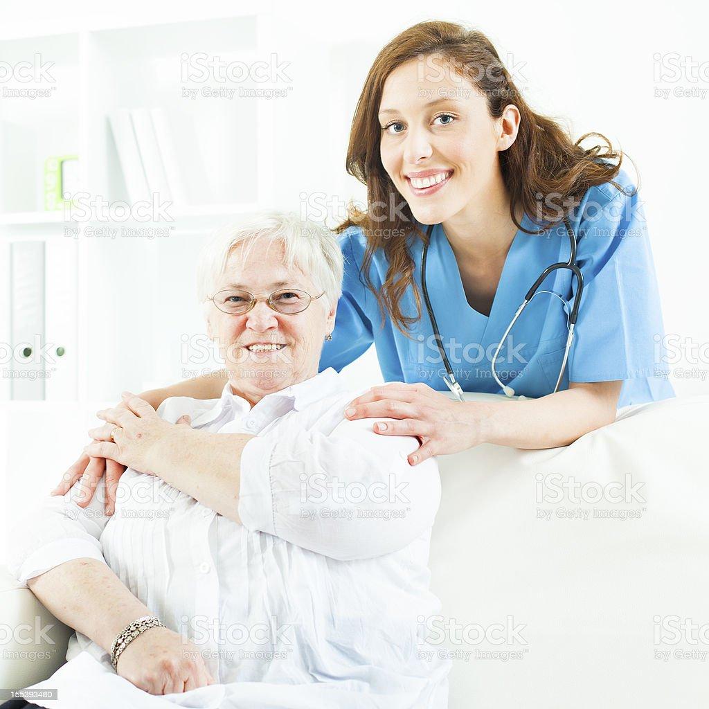 Doctor Encourage Senior Woman. royalty-free stock photo