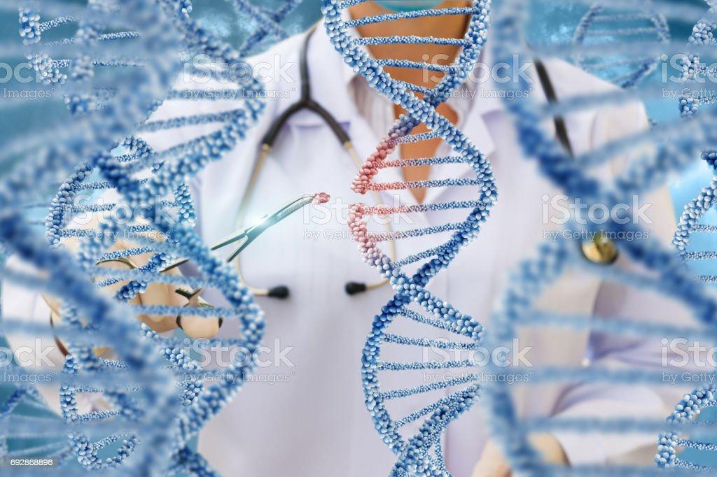 A doctor examines DNA molecules . stock photo