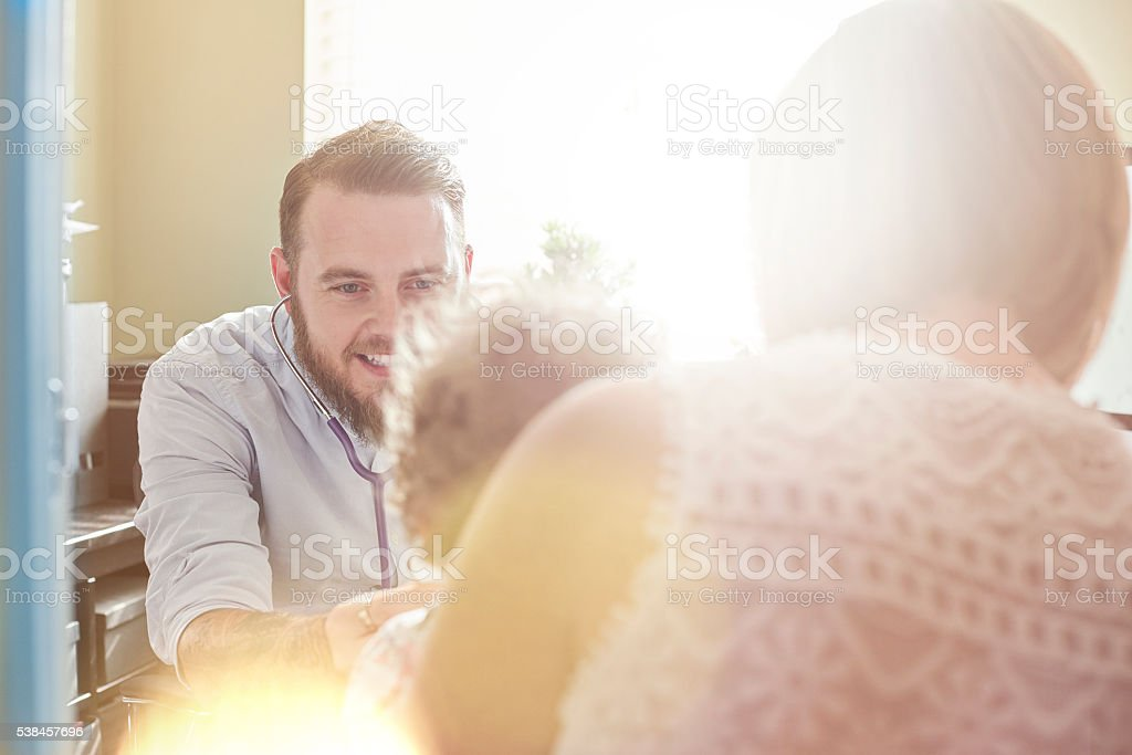 Doctor examines toddler stock photo
