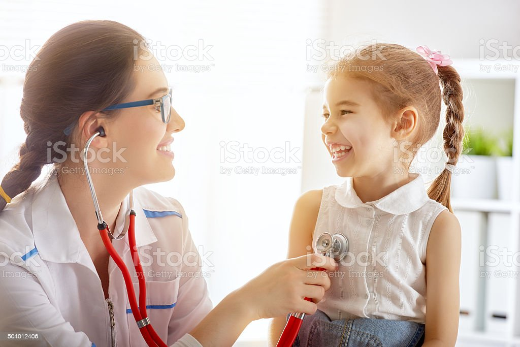 doctor examining a child stock photo