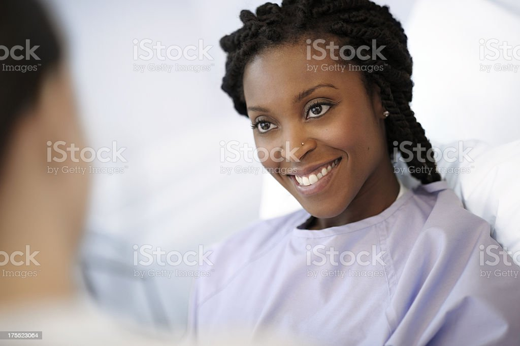 Doctor Examining a female hospital patient. stock photo
