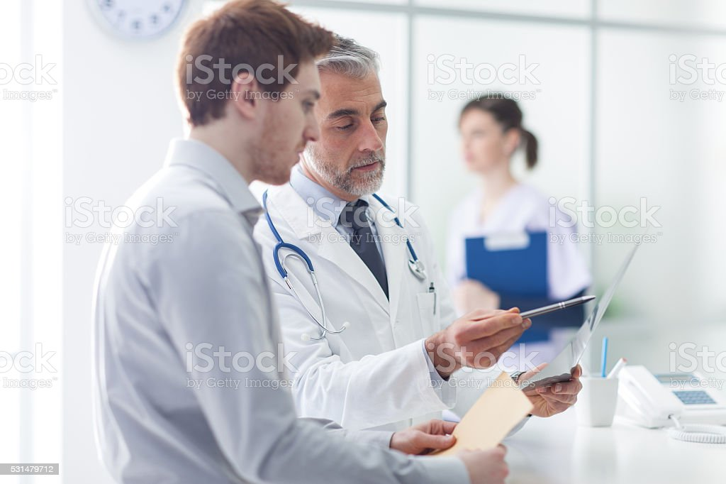 Doctor examining a patient's x-ray stock photo