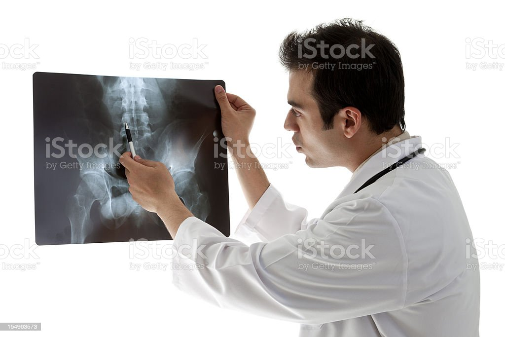 Doctor examining a Sacrum X-ray stock photo