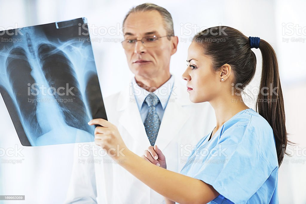 Doctor examining an x-ray image. stock photo