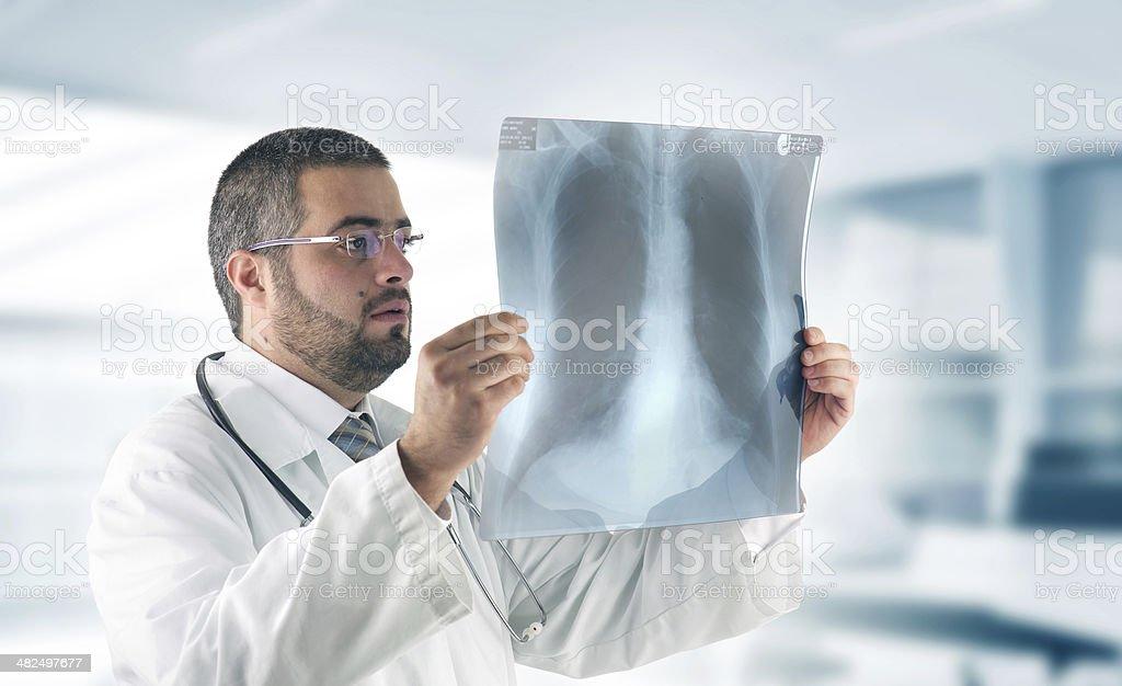 Doctor examining an X-Ray Image stock photo