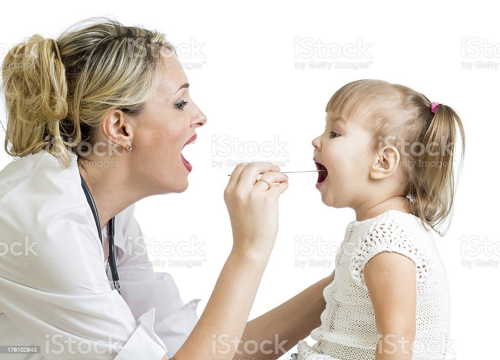 doctor examining baby stock photo