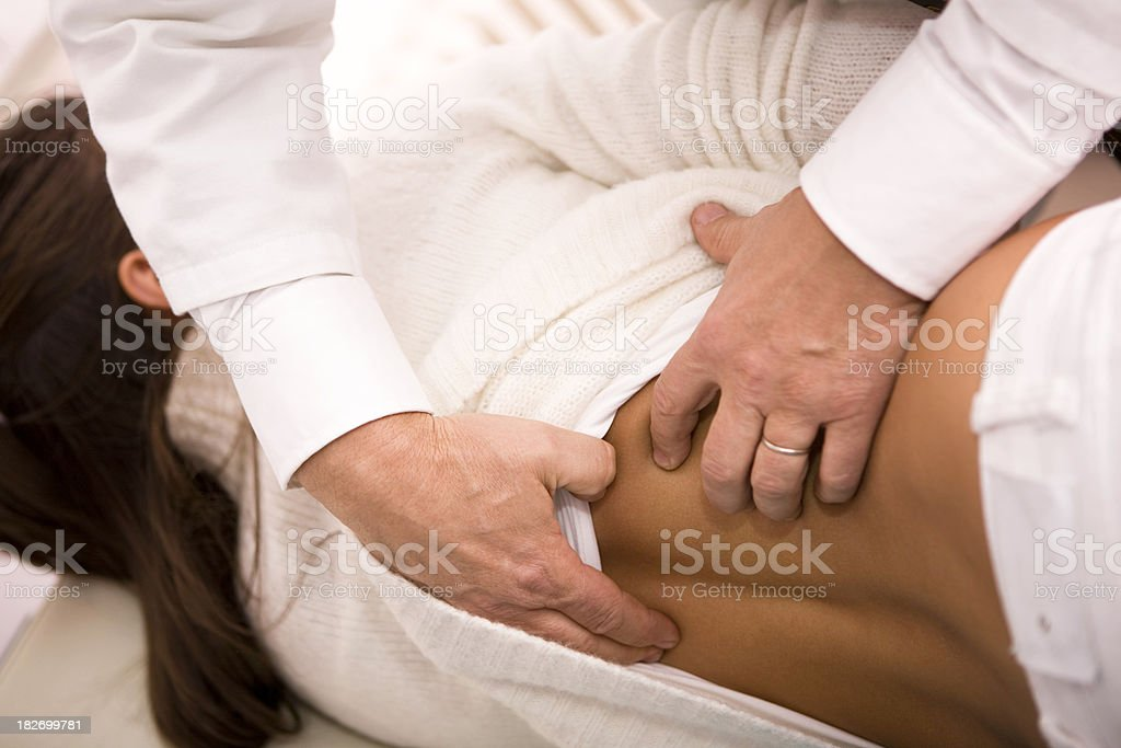 Doctor examining back stock photo