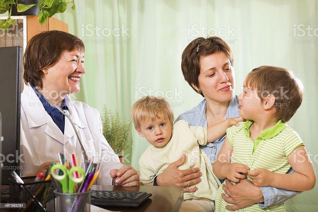 Doctor examining children stock photo