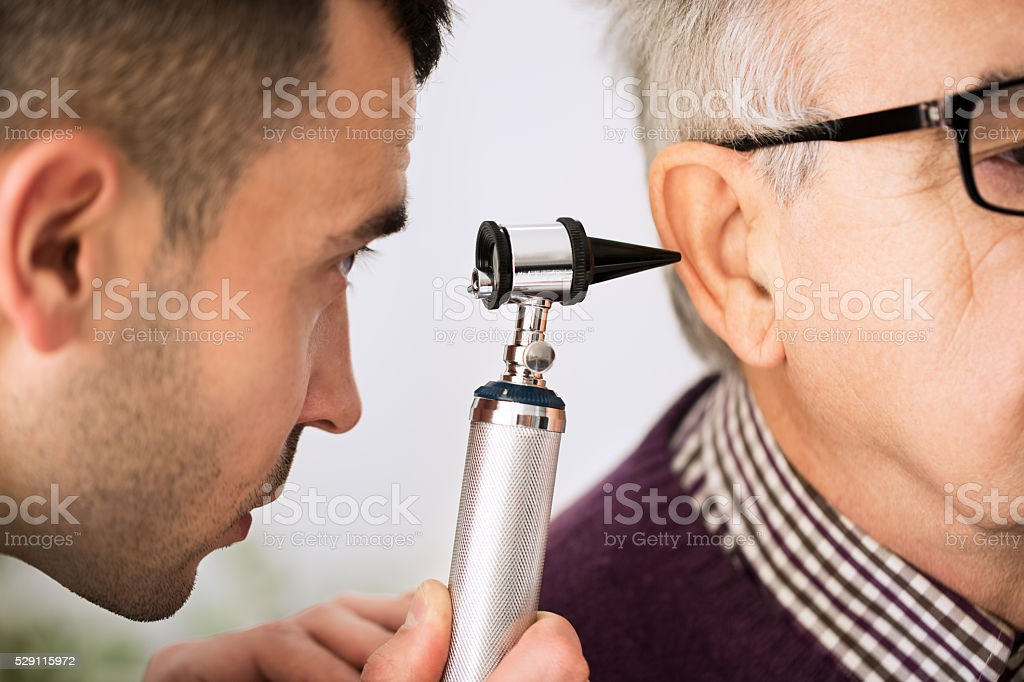 Doctor Examining Ear of a patient stock photo