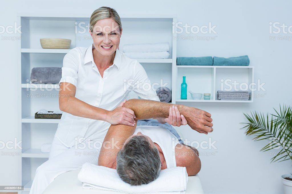 Doctor examining her patient arm stock photo