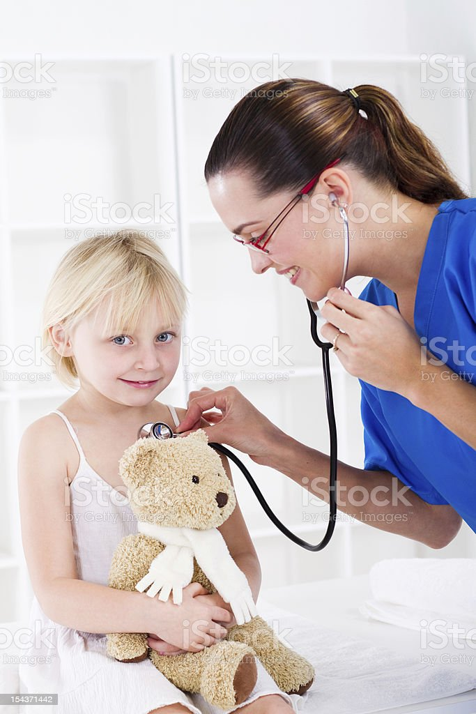 doctor examining little patient royalty-free stock photo