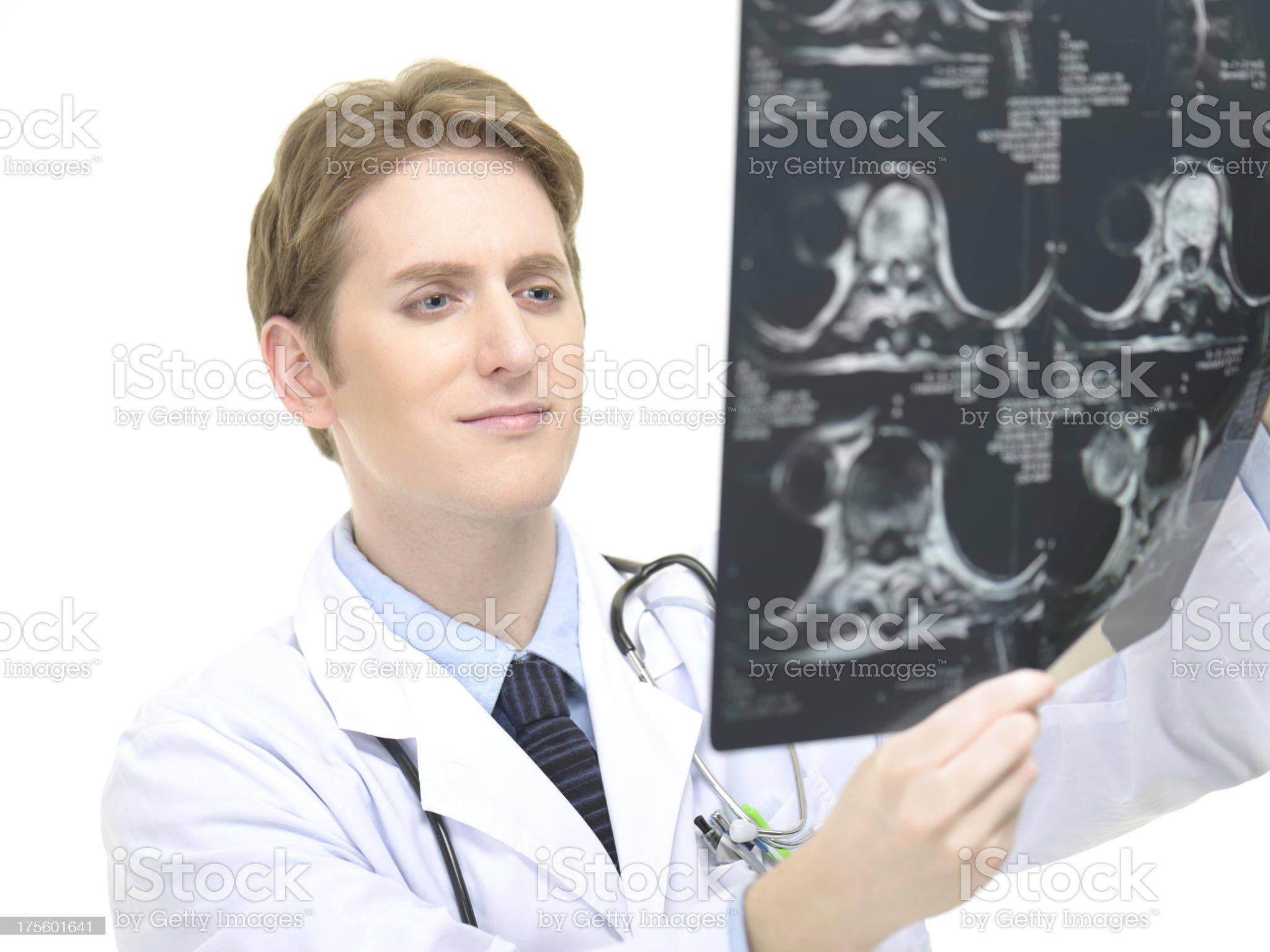 Doctor examining MRI scan royalty-free stock photo