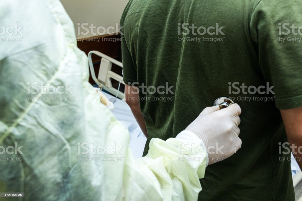 Doctor examining patient royalty-free stock photo