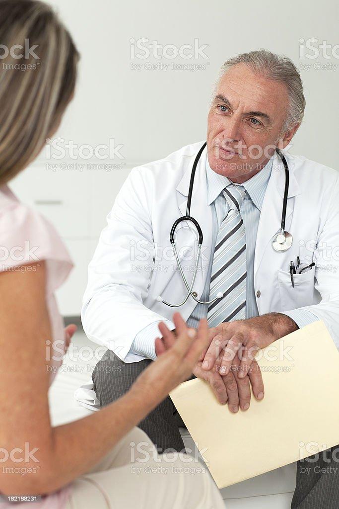Doctor examining senior patient royalty-free stock photo