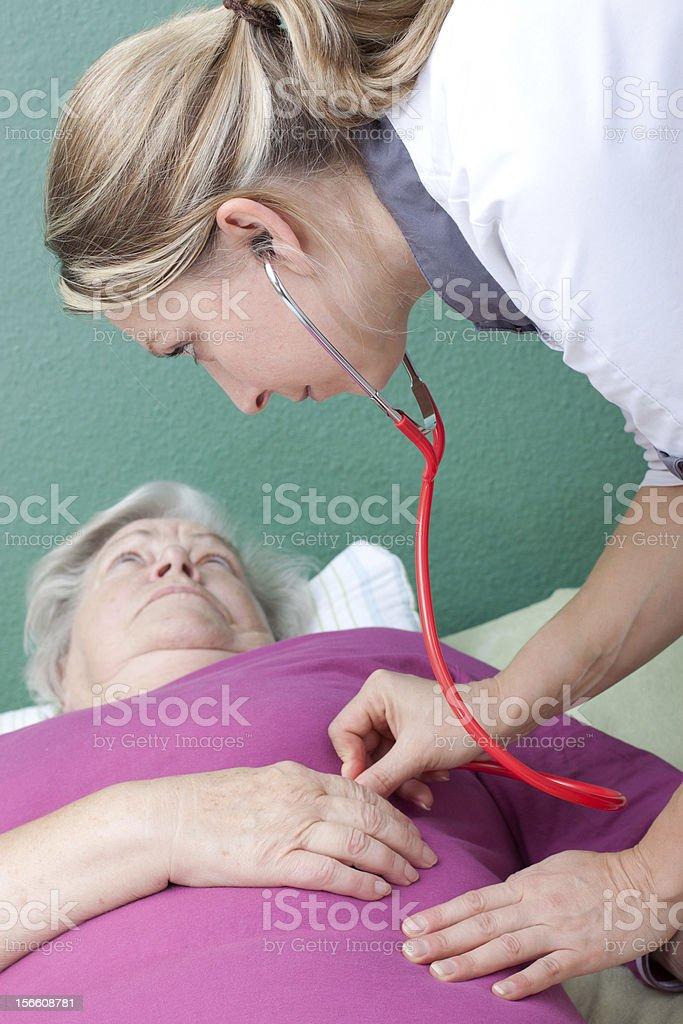 doctor examining senior with stethoscope royalty-free stock photo