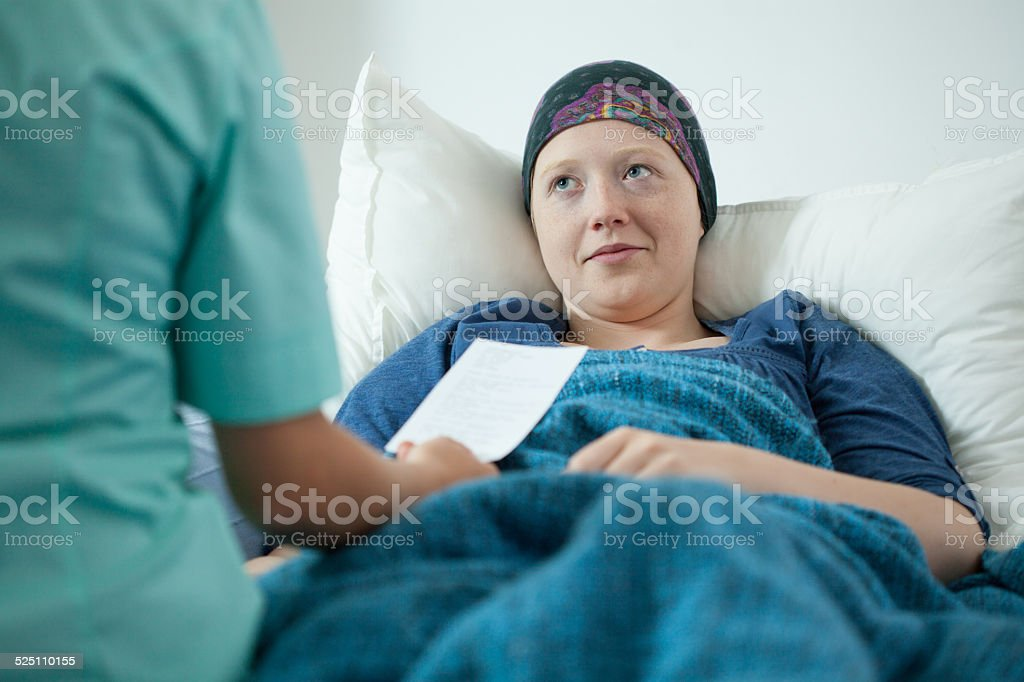 Doctor examining sick woman stock photo