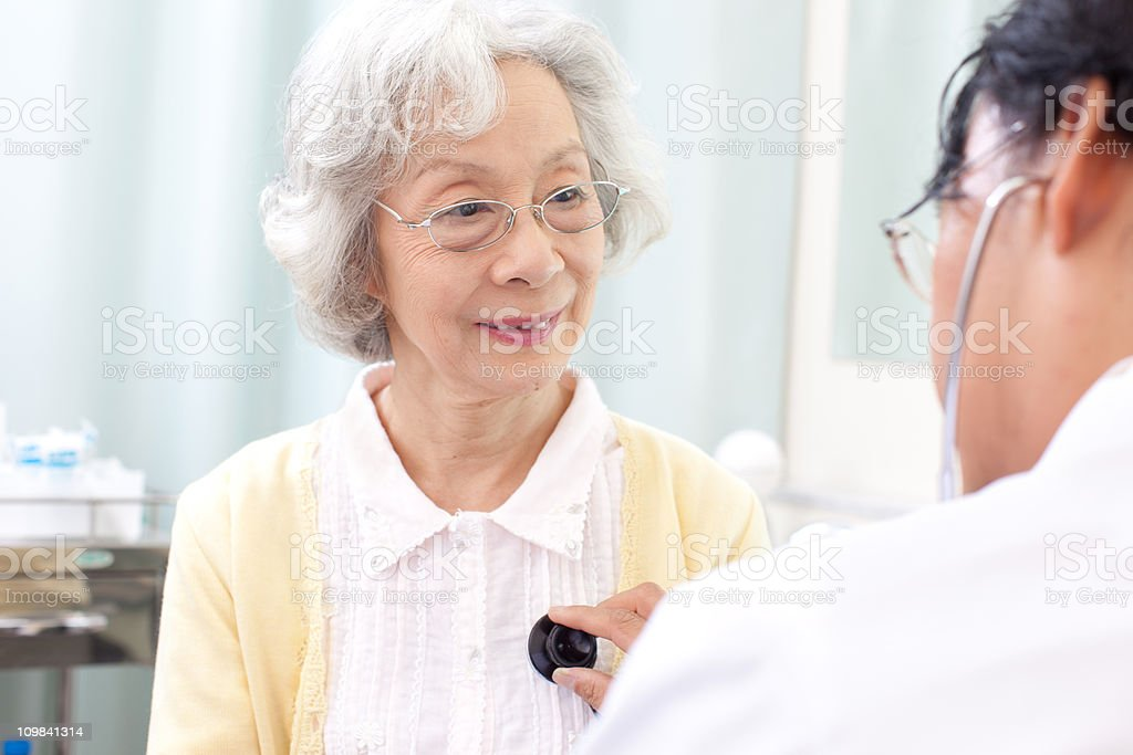 Doctor examining the patient royalty-free stock photo