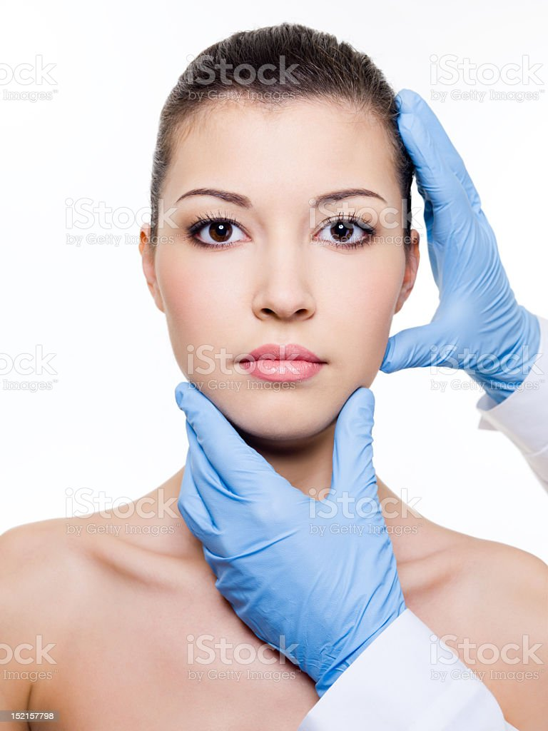 Doctor examining woman for facial plastic surgery royalty-free stock photo