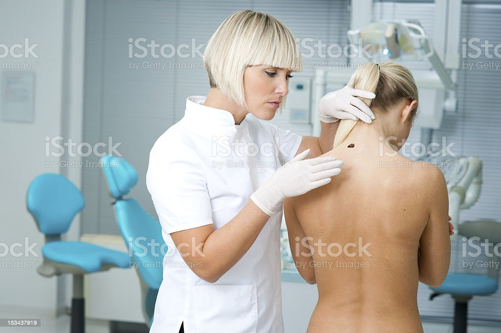 doctor examining woman skin royalty-free stock photo